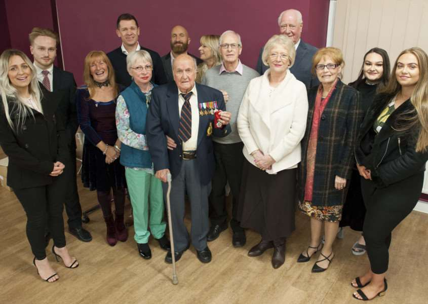 Presentation the Legion De Honouer to Roland Worth. Pictured in centre Roland Worth with his award and family.