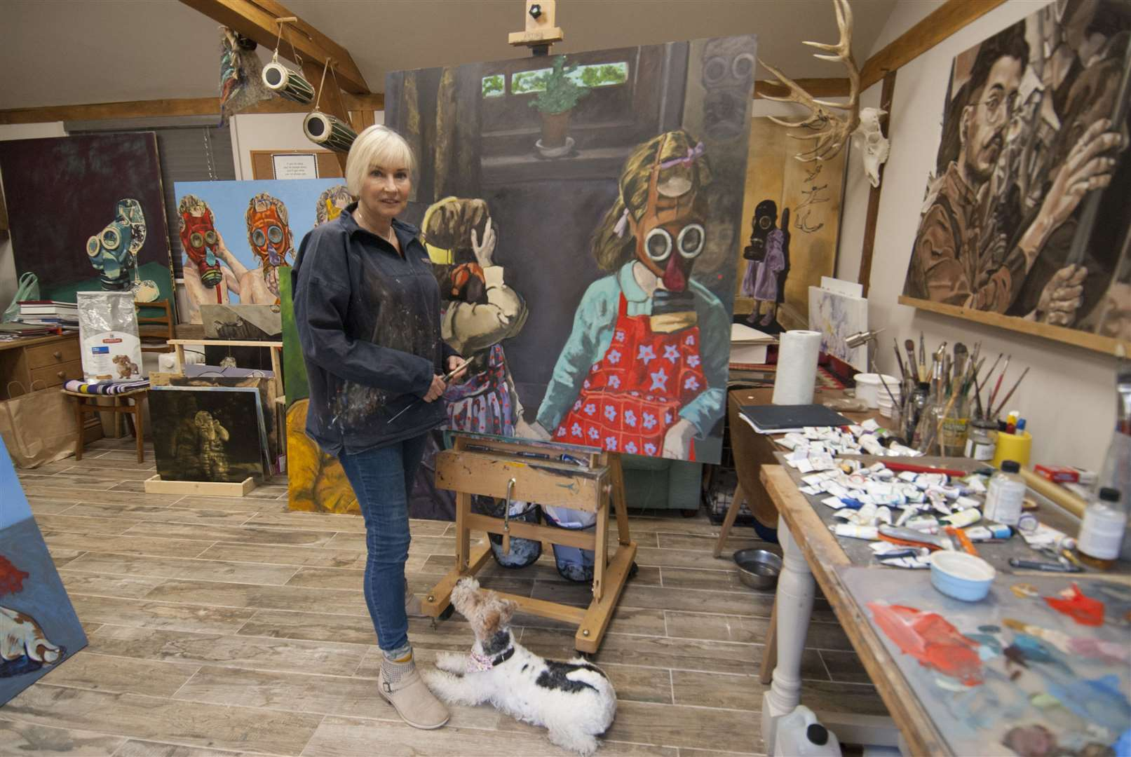 Terri Broughton with one of her artworks. Terri was due to hold an exhibition at Pensthorpe Natural Park in December but the event has since been cancelled by the park. Picture: SUBMITTED. (19832949)