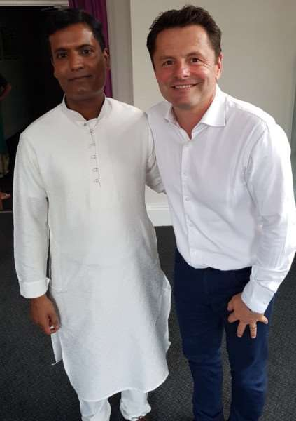 Anwar Ali, owner of Downham Tandoori, left, with BBC presenter Chris Hollins, host of the tandoori's 20th anniversary celebrations. Photo: SUBMITTED.
