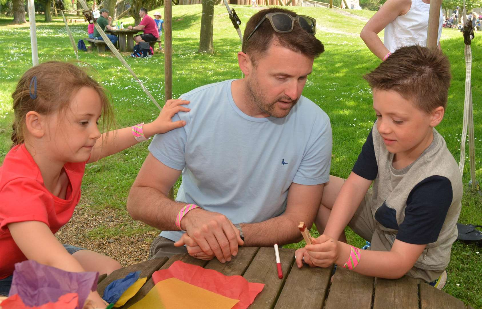 Father James helps Edward and Anna Thomas decide what they are going to make in the craft activities tent (2265895)