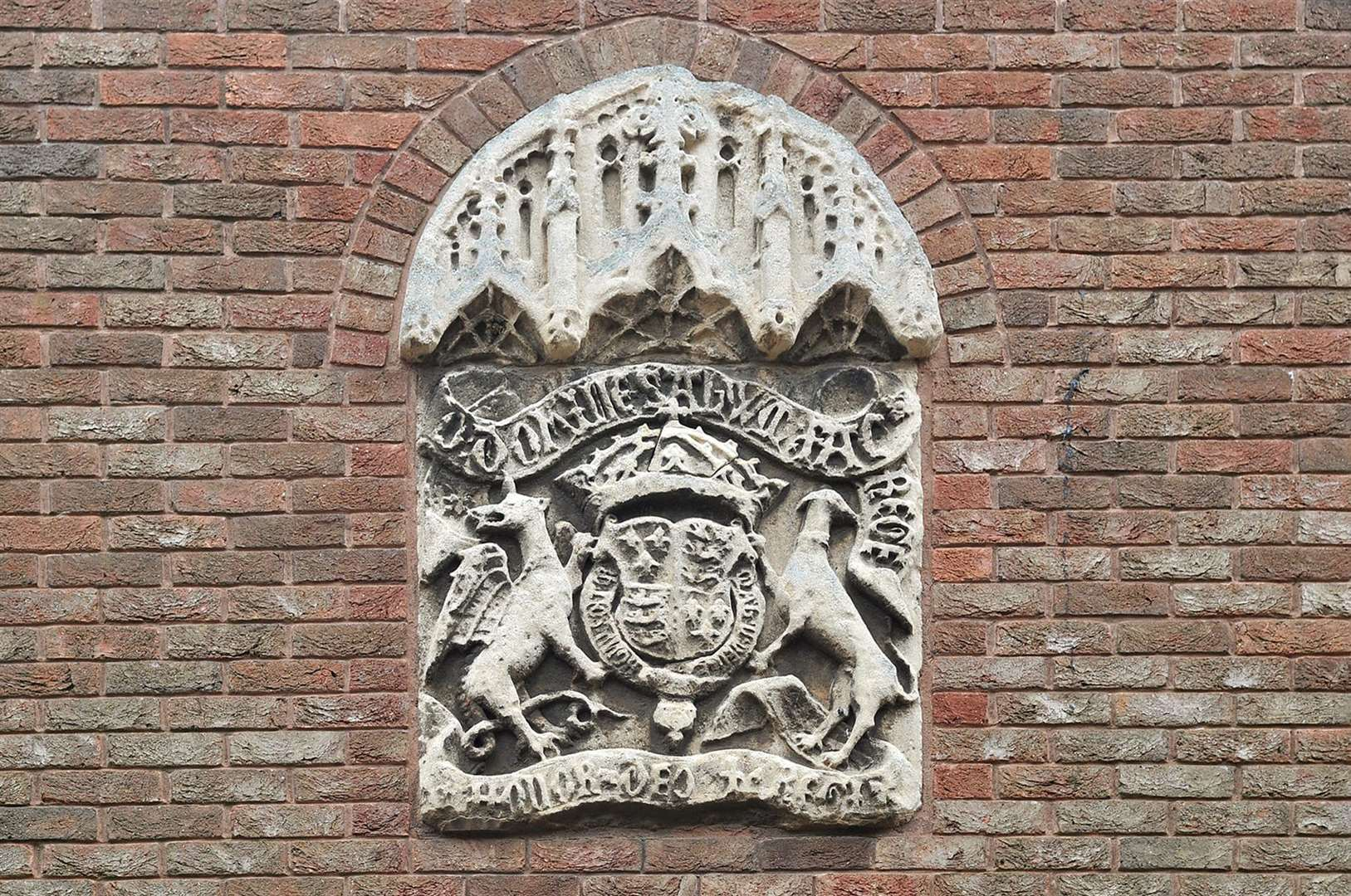 The crest above the entrance to King's Lynn Court in College Lane
