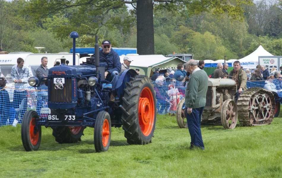 Stradsett Country Rally. Pictured vintage Tractors entering the arena.