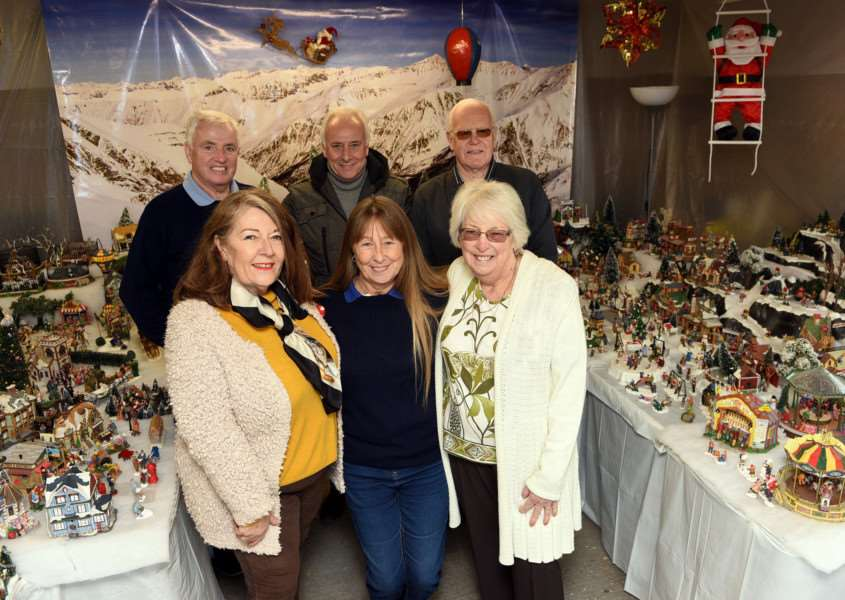 Christmas model village to fundraise money for MAPGAS and SSAFA Left to right back John Gilmurray, Colin Caulfield, John Granger Left to right front Lynn Brosnan, Jane Gilmurray and Eileen Granger