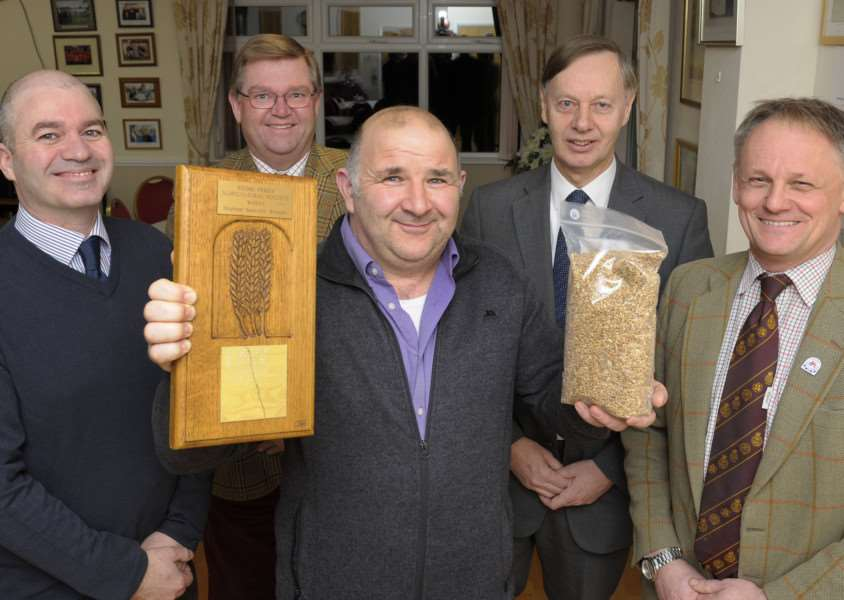 Annual Wheat Competition for Stoke Ferry Agricultural Society.'Winter Wheat 1st prize winner Robert Smart (centre), with LtoR, Paul Wortley (Chairman SFAS), Alex Ison (Guest Speaker Cruso & Wilkin), Mark Haydon (Guest Speaker Whiting & Partners), Andrew Blenkiron (Guest Speaker Euston Estate Suffolk)