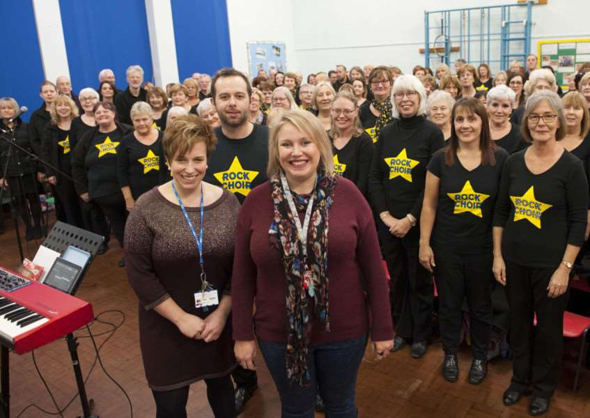 Norfolk Rock Choir rehearsing at Howard Nusery and Infant School for the charity Christmas shows raising money for the QEH Children Ward Christmas Toys etc. Pictured Front FltoR Leanne Crawford (QEH) Mike Tandy (Norfolk Rock Choir) Laura Shephered (QEH) with The Norfolk Rock Choir.