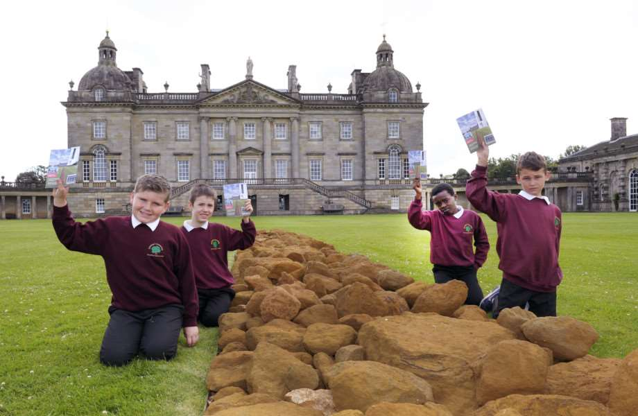 BeLong Education Project at Houghton Hall with pupils from Fairstead Primary School, King's Lynn 'Pupils with a backdrop of Houghton Hall and the Sculpture, A Line in Norfolk, LtoR, Jake Clarke, Michael Bramham, Tony Mbazi, Liam Massingham