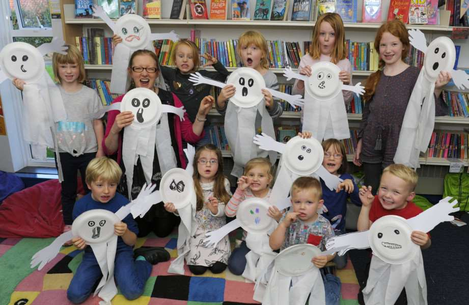 Halloween Creepy Crafts event for Children at Dersingham Library'Alison Thorne with some of the children at the event