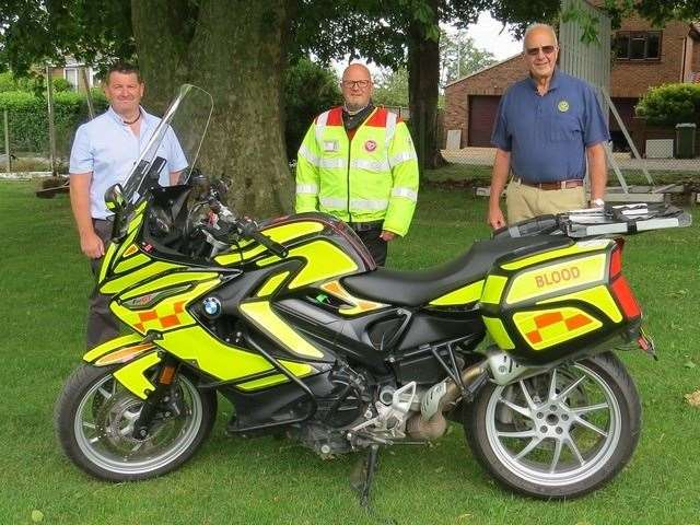 Downham Market Rotary Club's donation to Norfolk Blood Bikes. From left,Rotary secretary Shaun Button, Centre Martin Calvert from Norfolk Blood Bikes, Right Howard Phillips, Downham Rotary President. Picture: SUBMITTED. (38230952)