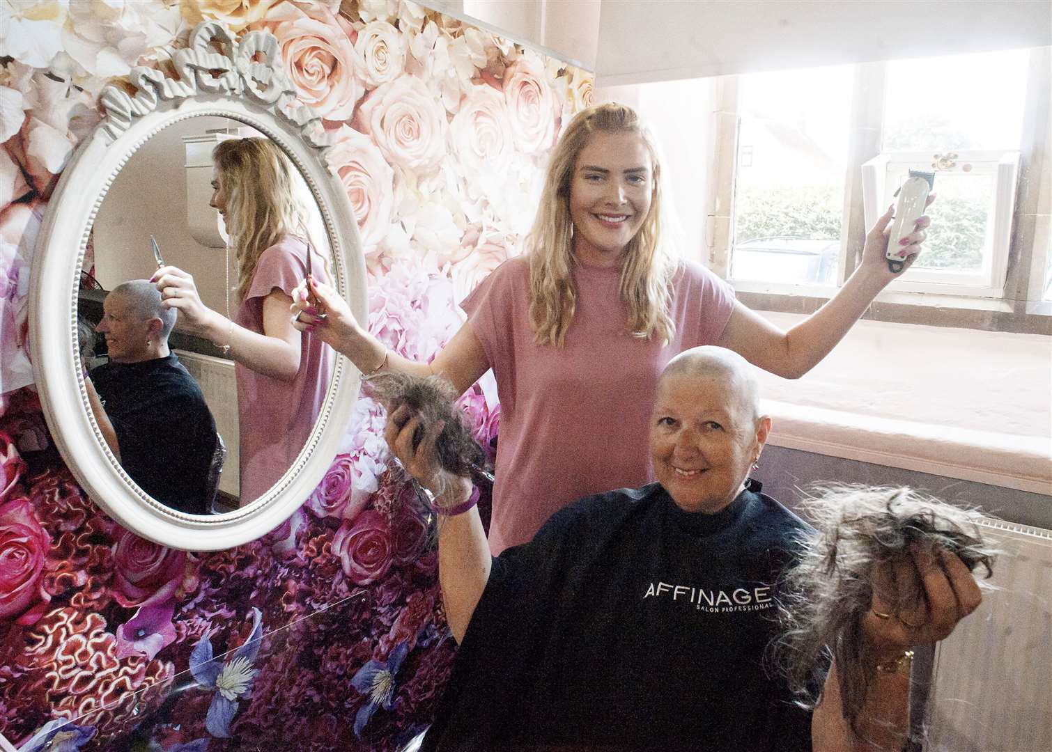 Patricia Nevin completes her Brave The Shave with hairdresser Charley Davies at The Old School House Hair Company Old Hunstanton