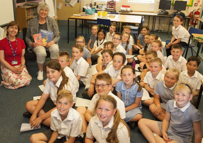 Author Jill Murphy visits South Wootton Juinor School Pictured Seated Author Jill Murphy . Teacher Tina Tostevin with pupils of year four.