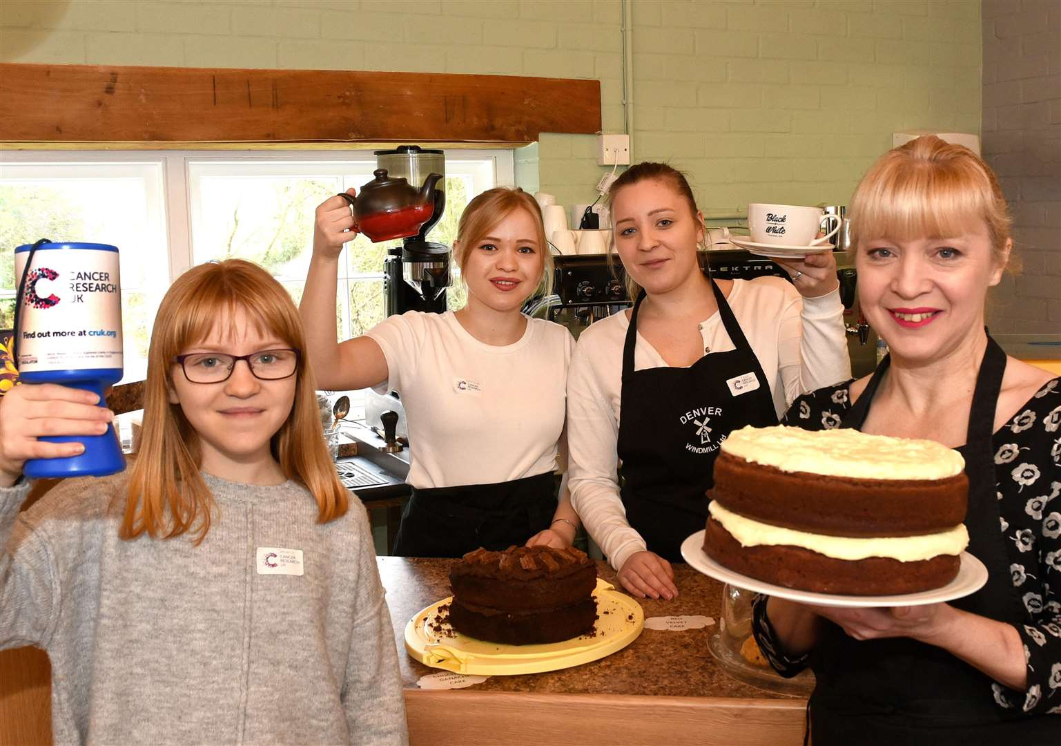 Re Opening of the Millstone Tearoom at Denver Windmill, also holding a Cancer Research UK cake bake etc fundraiser..Millstone Tearoom Manager Jill Wells, with her daughters LtoR, Jemma Eaglen (12), Beth Eaglen (21), Chloe Eaglen (23). (6928173)