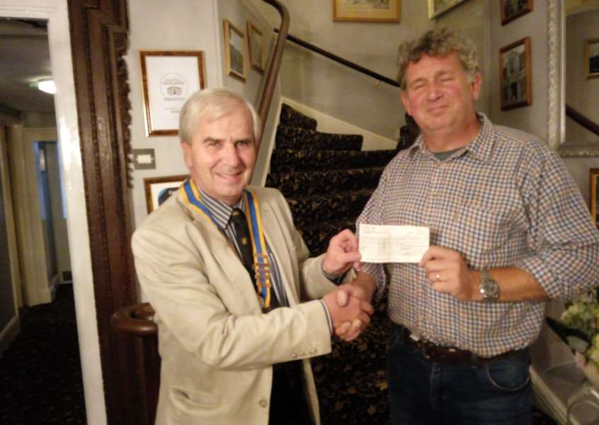 Downham Rotary president Martin Chilvers, left, receiving a cheque from Jonothan Soames-Waring, who helps organise the Fenman Classic Bike Show. Photo: SUBMITTED.